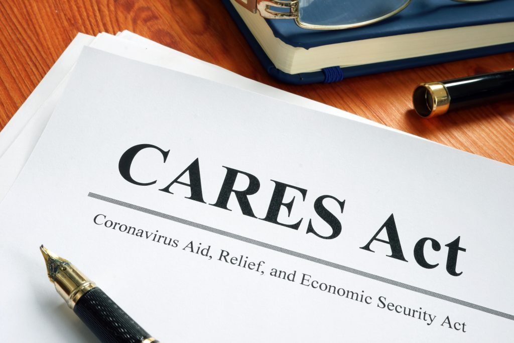 CARES Act document and pen
