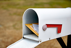 Photo of a mailbox filled with mail