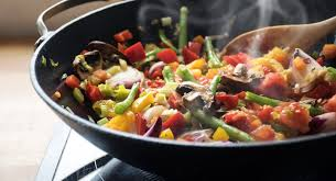 roaster pan with a melody of cooked vegetables