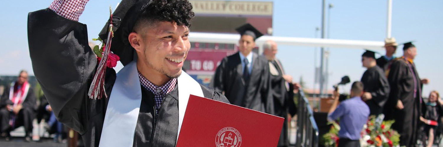 AVC Student on Commencement Day holding degree